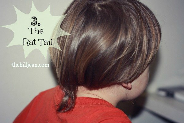 little boy with rat tail